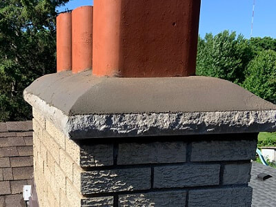 Sloped chimney crown
